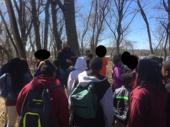 Students being introduced to the history of Kingman Island.